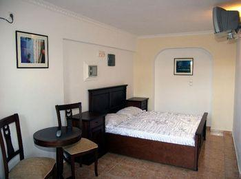 Комнаты Porto Perissa в строгом классическом стиле